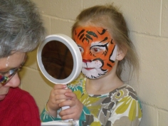 "She was told to ""roar like a lion..."" and she obliged after a deep look into the mirror, she emerged triumphant and bellowed, ""RRRRRRROOOOOOOOAAAAAAARRRRRRRR!"" After she was done with the whole self-affirmation-thing she ran into the crowd of kids roaring her head off like the proud tigress she had recently become."